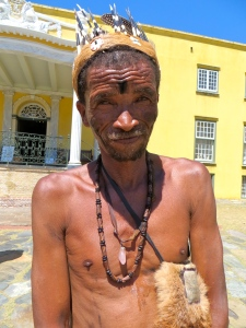 A Khoi San Medicine man in traditional dress posed in the courtyard of the colonial Cape Town Castle.